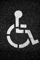 Handicapped symbol on pavement disability concept