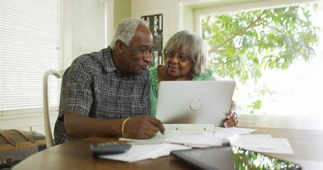 Senior black couple on the laptop computer