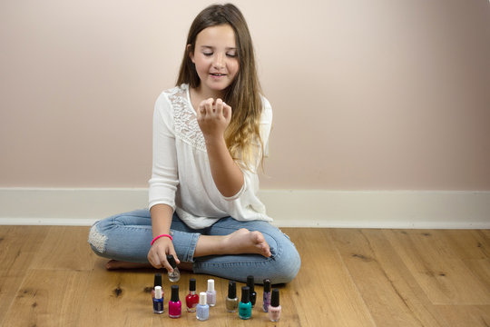 Young  girl painting nails.