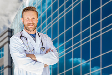 Handsome Young Adult Male Doctor With Beard In Front of Hospital Building