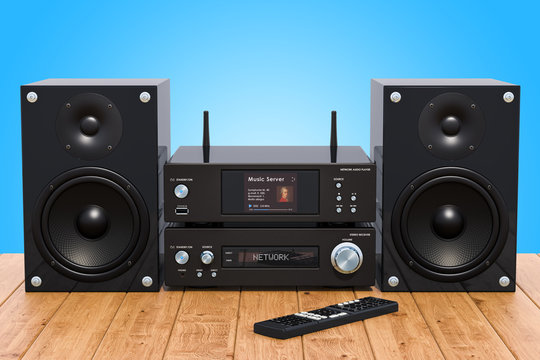 Home Stereo System on the wooden table, 3D rendering