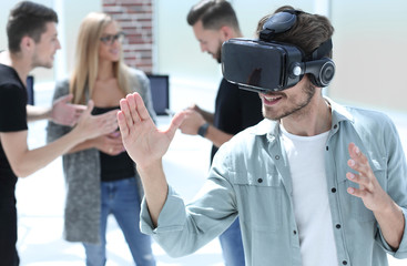 Young men with virtual reality goggles