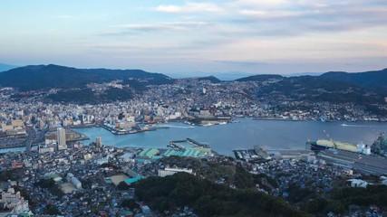 Wall Mural - Day to night timelapse of Nagasaki city skyline in Nagasaki, Japan
