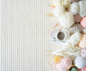 Yarn in a basket of beige and neutral, natural tones, knitting and crocheting. Spokes, succulent, scissors. White background.