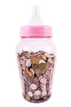 Large baby milk bottle fill with Thai baht coins money isolated on white background