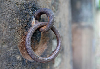 Old iron ring affixed to wall