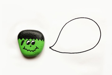 Painted Cartoon Halloween Monster Rock on White Background with Empty Speech Bubble