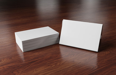 White business card stack on wooden desk 3D rendering