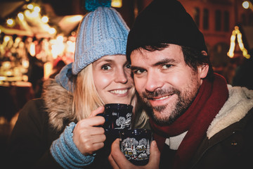 couple hot wine christmas market