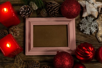 pink wooden frame with Christmas ornament