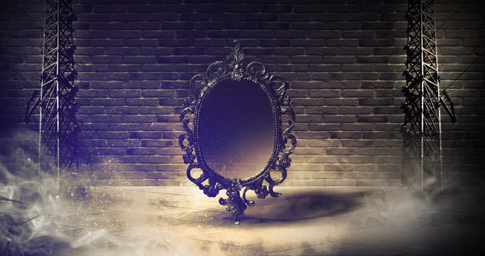 Mirror magical, fortune telling and fulfillment of desires. Abstract dark background of basement, brick walls, solar and neon light, smoke.