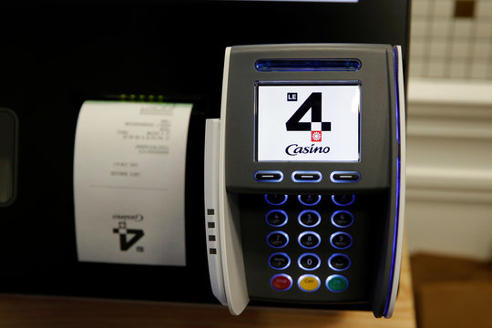 "The logo ""Le 4 Casino"" is seen on a credit card machine inside a high-tech store of supermarket retailer Casino in Paris"