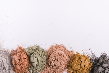 Set of different cosmetic clay mud powders on white background Fototapete