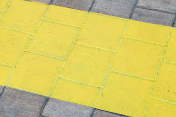 wide painted yellow line on pavement