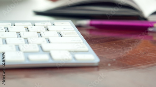 Wall mural close up keyboard and notebook background