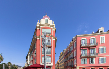 Red buildings on Plaza Massena square in Nice, France