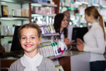 Smiling girl in a pharmacy