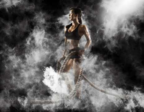 Woman working out with battle ropes