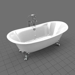 Half full clawfoot bathtub with water on
