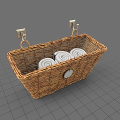 Woven storage basket with towels