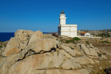 Rocky landscape with the lighthouse of Capo Testa at the Mediterranean sea, Sardinia, Italy