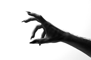 Black creepy halloween monster hand with long nails