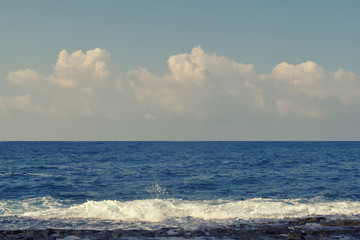 Calm sea surface with clouds