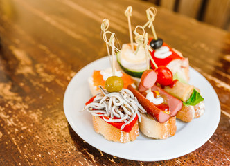 Spanish Tapas as traditional cuisine on vintage table in restaurant