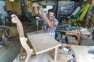 man working wood carpenter