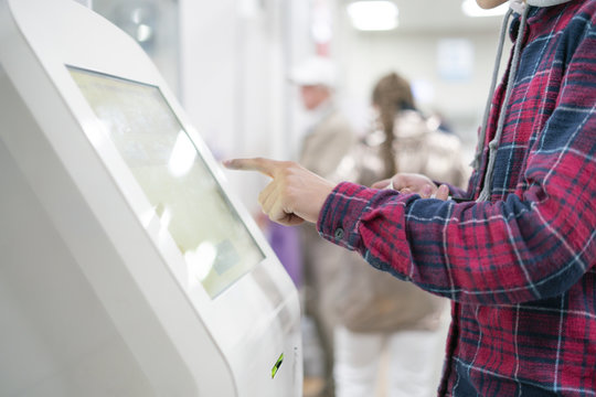 close up person using touch screen panel in post office to recieve a package f