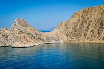 Jebha island and waves and rocks