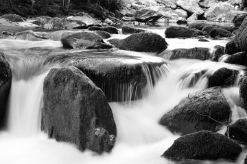Black and white photo of a waterfall at Watersmeet in Devon