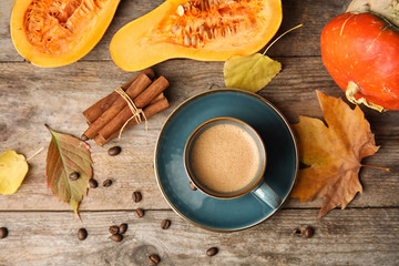 Flat lay composition with pumpkin spice latte in cup on wooden background