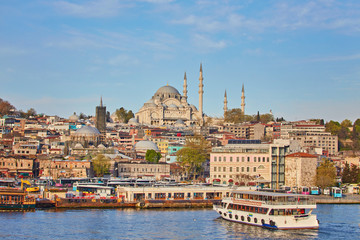 Istanbul cityscape with boats and Suleymaniye Mosque