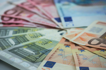 Euro banknotes, the currency of Europe sorted on a table
