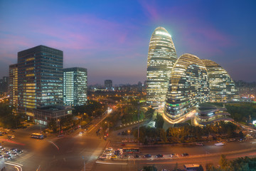 Beijing cityscape and famous landmark building in WangJing Soho area at night in Beijing, China.