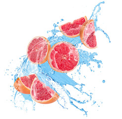 grapefruit slices in water splash on a white background