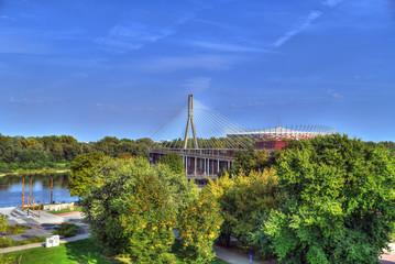 Colorful HDR image of gardens and the Swietokrzyski Bridge with the PGE Narodowy National Stadium in Praga District, Warsaw, Poland