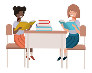 young student girls sitting in school desk
