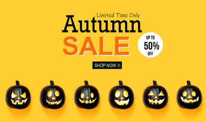 Halloween sale with black colored pumpkin lanterns