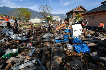 Search and rescue officers search an area hit by the earthquake and tsunami in Palu, Central Sulawesi