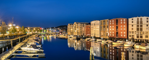 Panorama of the colorful houses and  the Nidelva River, Trondheim, Norway.