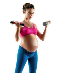 Sporty pregnant woman doing exercises with dumbbells isolated on white background. Concept of healthy life