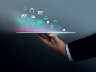 Digital Contents Marketing Concept. Businessman Holding Tablet to Present Many Icons, Side view, Dark tone