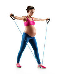Sporty pregnant woman workout with expander isolated on white background. Concept of healthy life