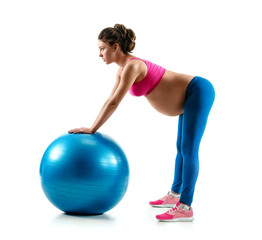 Pregnant woman exercising on gymnastic ball isolated on white background. Concept of healthy life