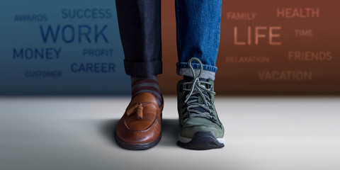 Work Life Balance Concept. Low Section of a Man Standing with Half of Working Shoes and Casual Traveling Shoes, Blurred Text on the Wall as background Wall mural