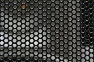 the texture of a shallow metal mesh that covers the speakers