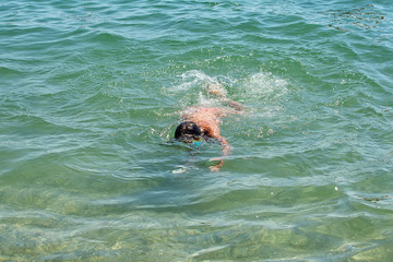 Beautiful Young Girl Diving at sea