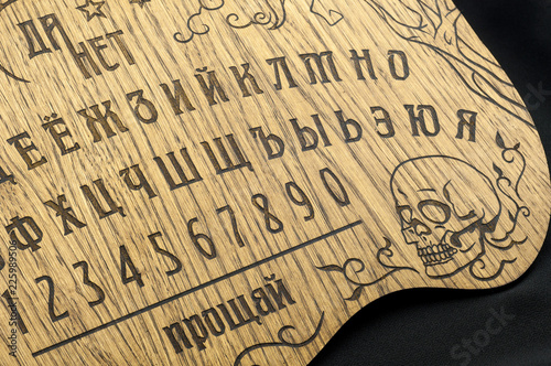 Ouija Board Yellow On A Black Background